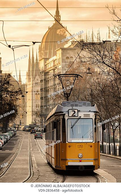 Tram at sunrise, Hungarian Parliament Building, Neogothic Style, National Assembly. Budapest Hungary, Southeast Europe