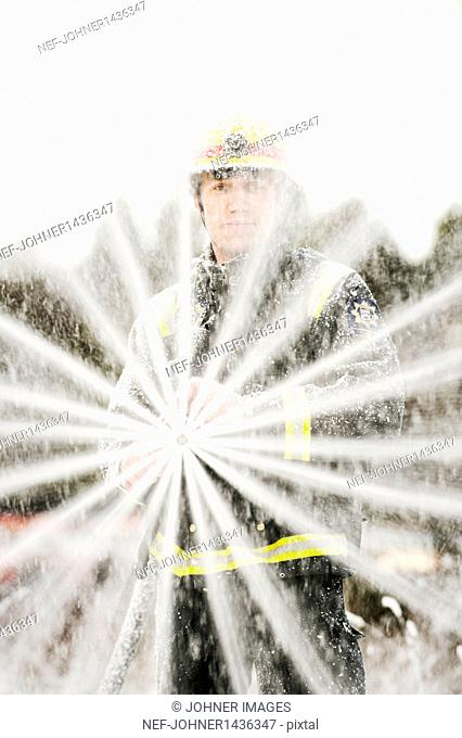 Fire fighter holding fire hose