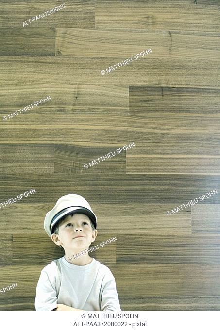 Boy wearing captain's hat