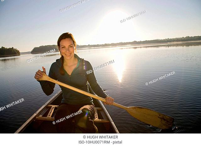 Woman canoeing in morning light