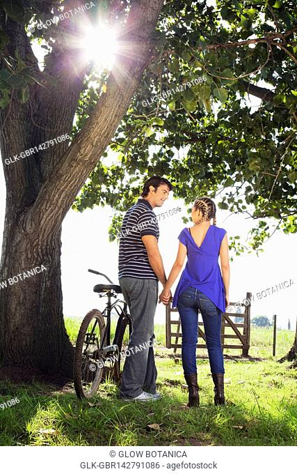 Rear view of a couple in a field