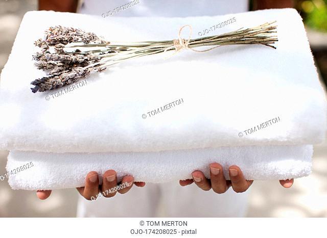 Man holding towels