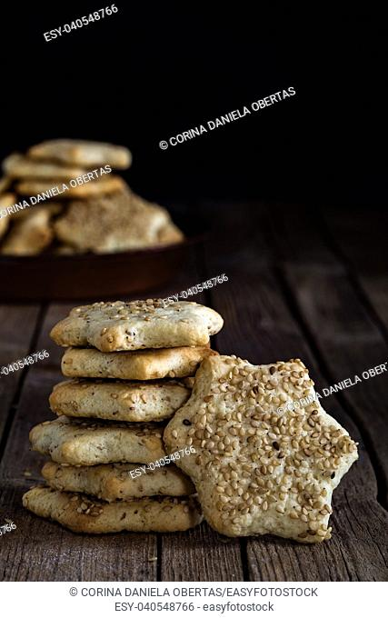 Star shaped biscuits with sesame seeds, made with Sicilian recipe, for winter holidays