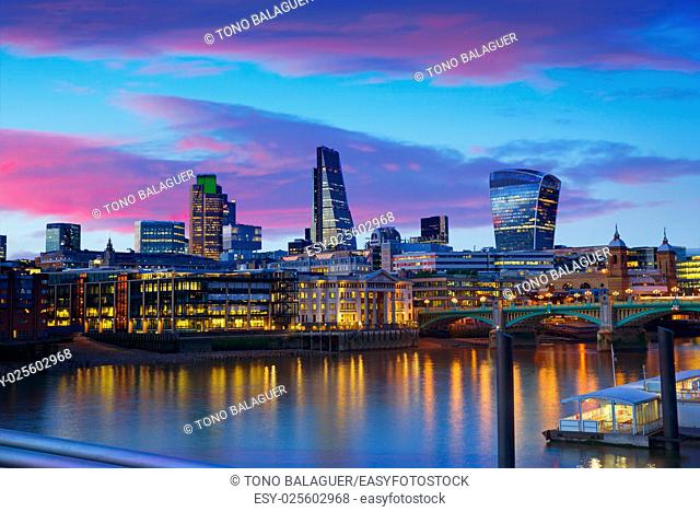 London skyline sunset on Thames river reflection at UK