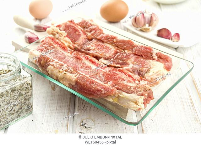 raw churrasco steak ready to be cooked with ingredients, on wooden board