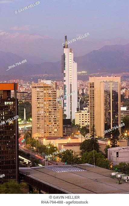 City skyline and the Andes mountains at dusk, Santiago, Chile, South America