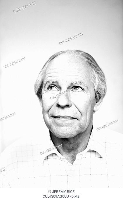 no studio portrait of senior man looking up