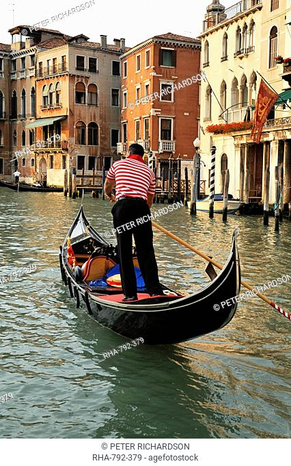Evening picture of a gondolier on the Grand Canal, Venice, UNESCO World Heritage Site, Veneto, Italy, Europe