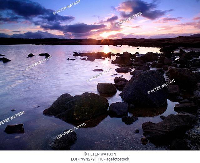 Scotland, Perthshire, Rannoch Moor. Winter sunset over Loch Eigheach on Rannoch Moor