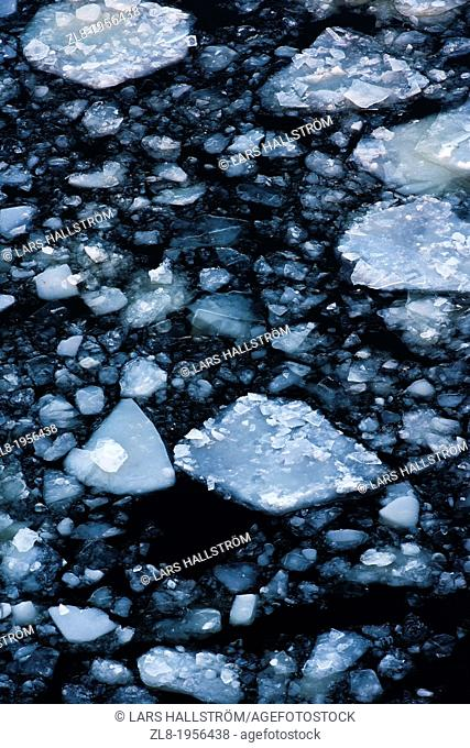 High angle view of ice sheets and dark sea water. Stockholm, Sweden