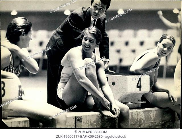 1964 - Tokyo Olympics: Dawn Fraser, chats with one of her team mates at the Olympic Pool. The Australian swimmer looks confident of winning a gold medal