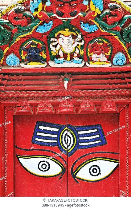 Wooden curved and Buddha eyes painted door at Gaa Kuti Mahadev in Durbar square