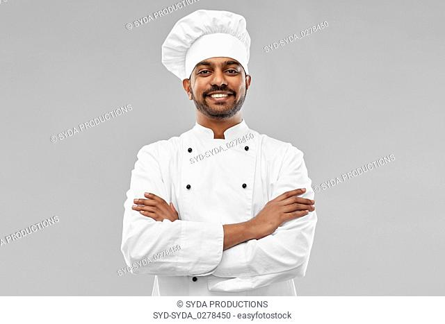 happy male indian chef in toque