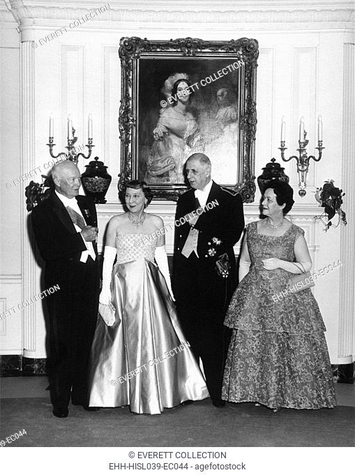 State dinner at the White House for French President Charles DeGaulle. L-R: President and Mamie Eisenhower, President and Mrs. Yvonne DeGaulle