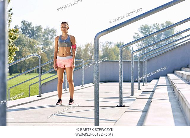 Young woman getting ready for outdoors workout