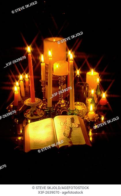 Candles surrounding open Bible with a cross on the pages. St Paul Minnesota USA