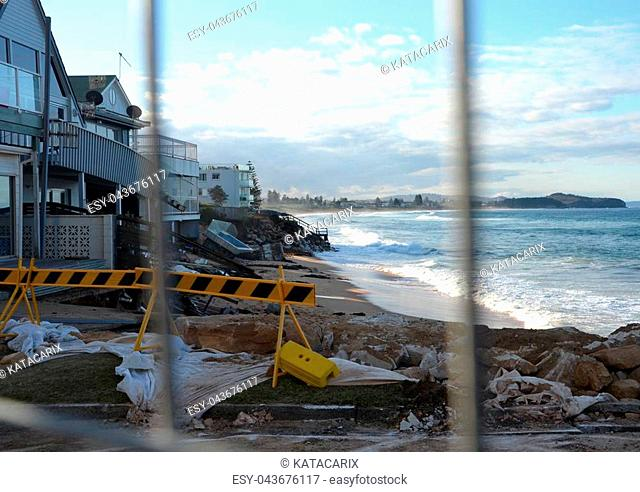 SYDNEY 13.06.2016, After the big storm, houses at Collaroy Beach front, behind the fence. The intense storm lashing the NSW coast has caused significant erosion...