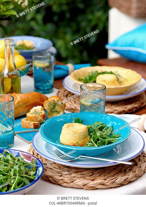 Plate of cheese souffle with salad