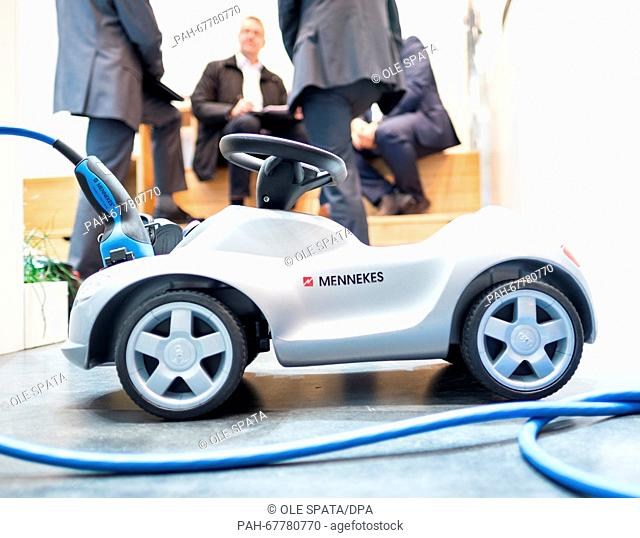 A charging cable for electric vehicles plugged into a model car at the stand of Mennekes at Hanover fair in Hanover, Germany, 26 April 2016