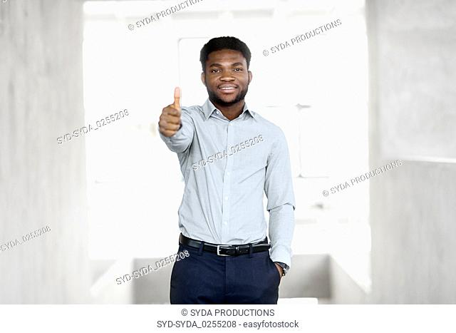 african businessman at office showing thumbs up