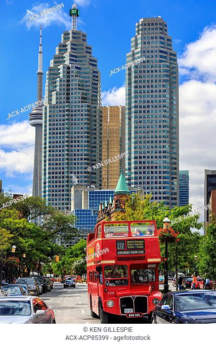 Double decker tour bus with downtown office towers, Toronto, Ontario, Canada
