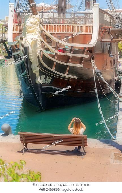 -Woman taking picture Galleon of Santísima Trinidad Replica- Alicante's Port Spain