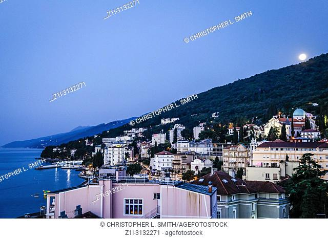 Rooftop view over the Croatian resort of Opaija Croatia as the moon rises at eventide