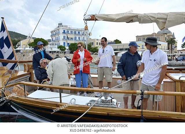 """King Constantine of Greece, Queen Anne-Marie with their son Prince Nikolaos of Greece on their traditional boat """"""""Afroessa at the port of Spetses island during..."""