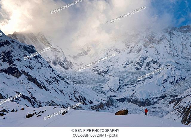 Hiker in snowy mountain landscape