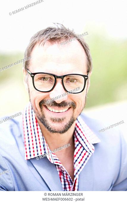 Germany, Bavaria, Portrait of businessman, smiling