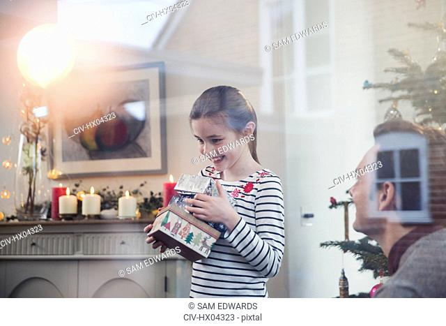 Eager girl gathering Christmas gifts