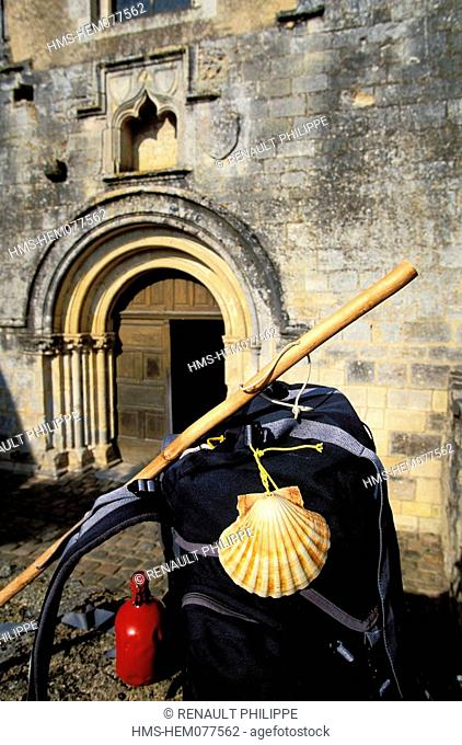 France, Vienne, pilgrimage of Compostelle, backpack of a pilgrim in front of the abbey of Fontaine Le Comte