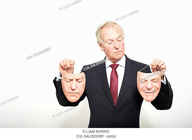 Businessman holding masks