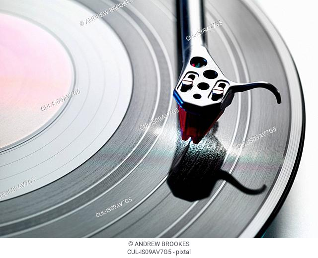 Overhead close up of turntable stylus playing a vinyl record