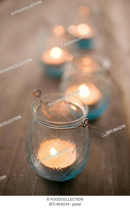 Windlights on wooden table