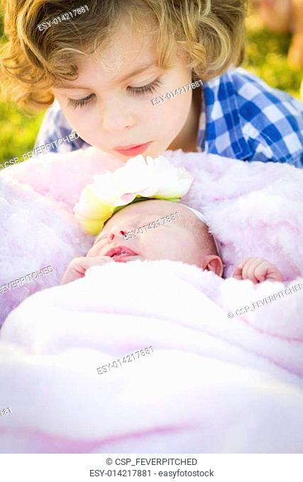 Young Boy Gazing at His Newborn Baby Girl Sister