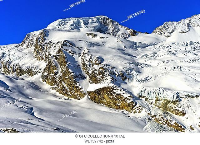 The snow-covered peak Alphubel, Pennine Alps, Saas-Fee, Valais, Switzerland