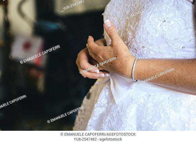 Hands of the bride while playing with wedding ring