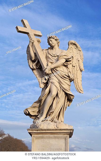 White marble statue of winged female angel holding cross on Ponte Sant Angelo Bridge, Rome, Italy