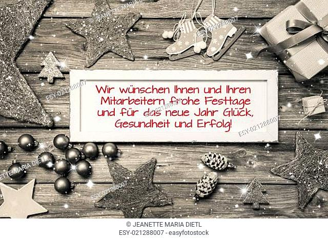 Greeting card for christmas with german text for merry christmas. Idea for employees and customers in red font