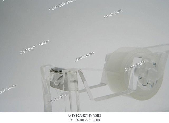 Still-life of tape dispenser, studio shot