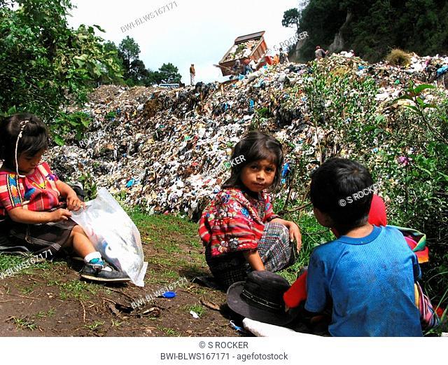 Playing Mayan children in waste deposit, Guatemala, Quiché