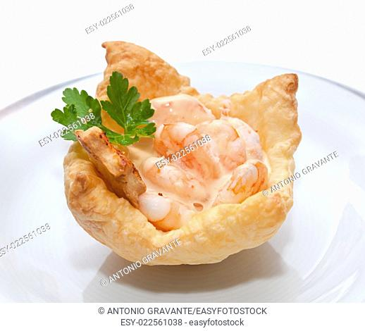 Shrimp cocktail in the puff pastry on christmas table