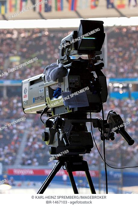 Film camera on a tripod at a sporting event in the Olympic Stadium in Berlin, Germany, Europe