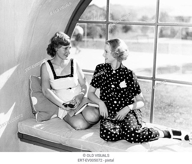 Two women in front of a window looking at each other All persons depicted are not longer living and no estate exists Supplier warranties that there will be no...