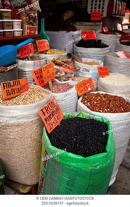 Beans, corn, cacao, lentiles and peanuts in sacks at a shop in the market at the historic center, Oaxaca, Oaxaca State, Mexico, North America