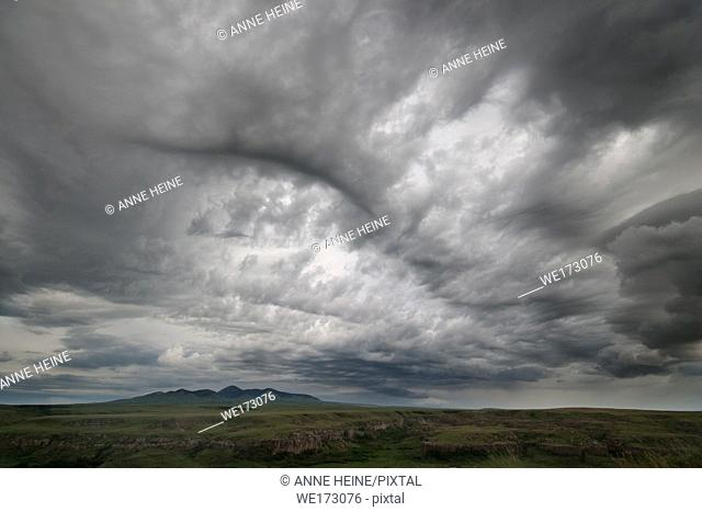 Storm clouds over the protected grassland in Writing on stone Provincial Park, Alberta, Canada