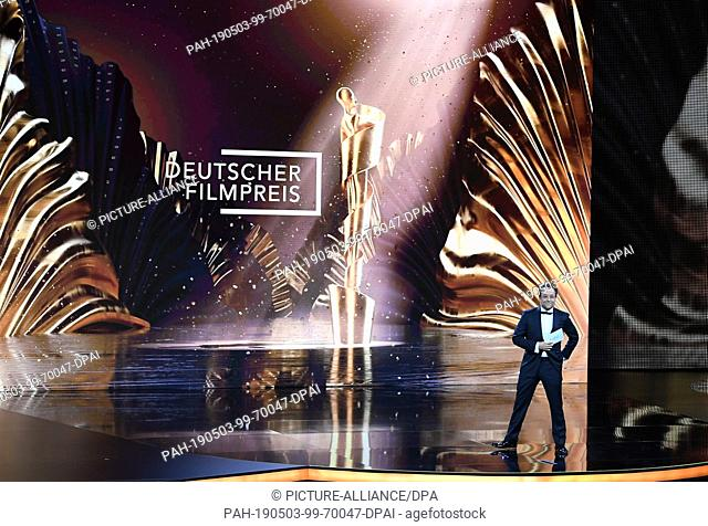 """03 May 2019, Berlin: Actor and laudator Jan Josel Liefers speaks at the 69th German Film Award """"""""Lola"""""""" on stage before the award of the Lola in the category..."""
