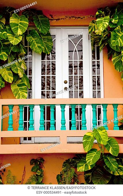 A balcony and door at the Lazy Parrot hotel in Rincon, Puerto Rico