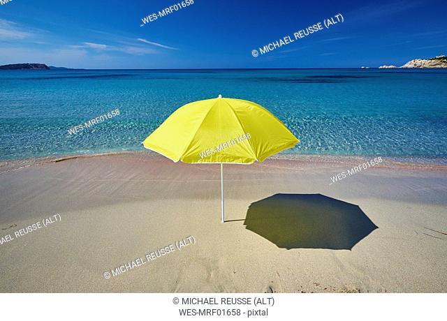 Italy, Sardinia, yellow sunshade on the beach at Rena Majori